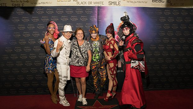 Cast members from Michael Jackson ONE pose for photos on the red carpet, Aug. 29, 2017 (Photo Credit: Michael Jackson ONE by Cirque du Soleil)
