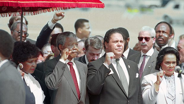 (Original Caption) Atlanta. Mayor Maynard Jackson (C) and Coretta Scott king, widow of slain civil rights leader Dr. Martin Luther King, Jr., join Nelson Mandela in holding up clenched fists during the playing of the Anthem of Mandela's African National Congress upon Mandela's arrival.