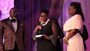 Botham Jean's mother, Allison Jean, gives an acceptance speech during the Godís Leading Ladies gala while Bishop T.D. Jakes and Sybrina Fulton look on.