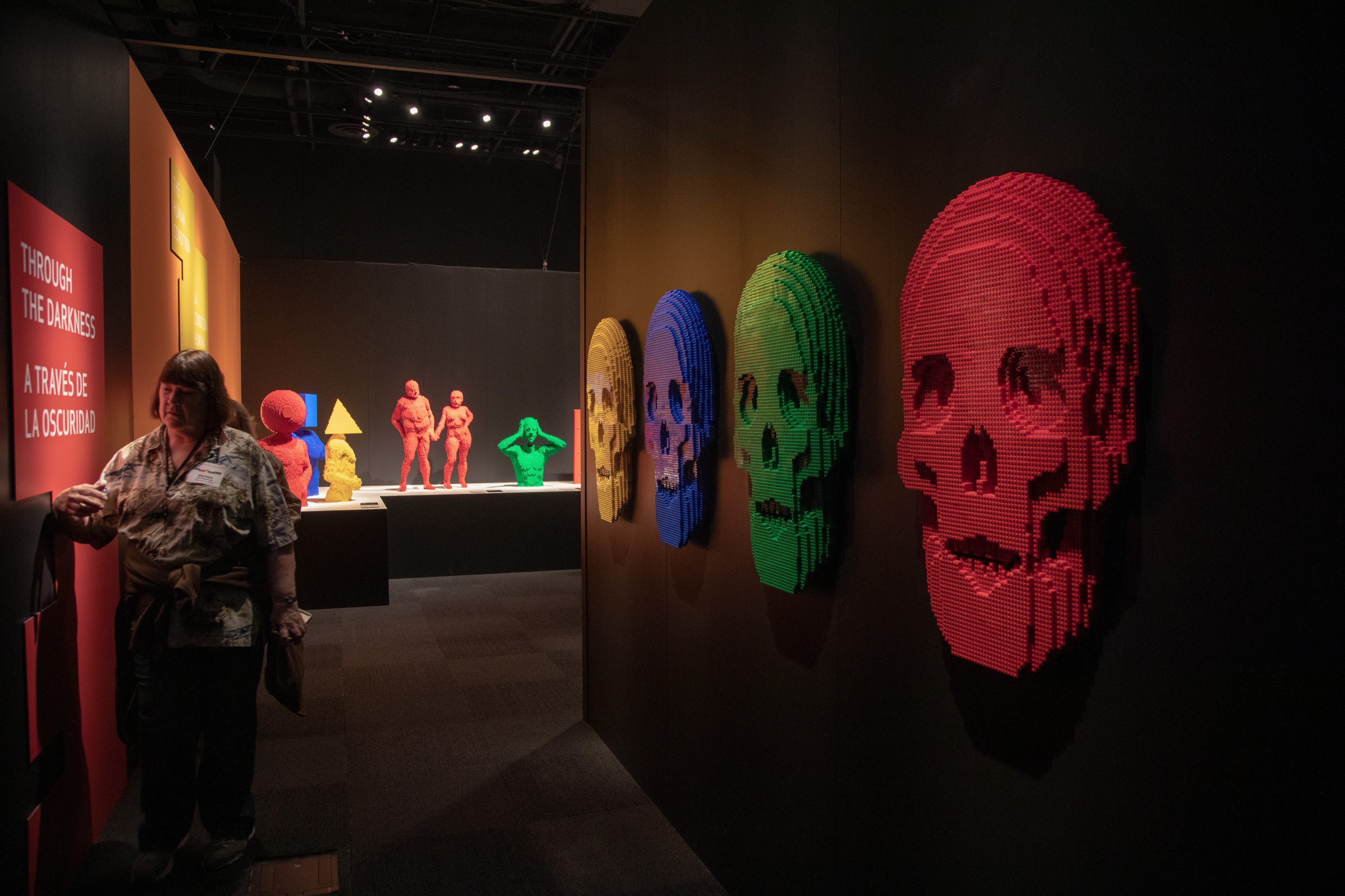 "Skulls adorn the walls in the ""Through the Darkness"" gallery of The Art of the Brick traveling exhibition (PHOTO CREDIT: JerSean Golatt/Perot Museum of Nature and Science)"