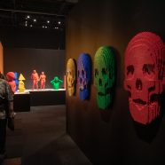 """Skulls adorn the walls in the """"Through the Darkness"""" gallery of The Art of the Brick traveling exhibition"""