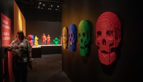 "Skulls adorn the walls in the ""Through the Darkness"" gallery of The Art of the Brick traveling exhibition"
