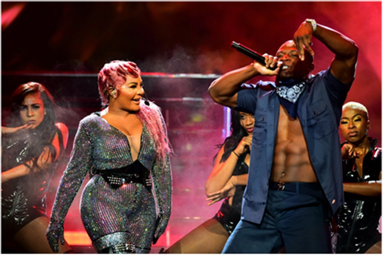 """2019 """"I Am Hip Hop"""" Award recipient Lil' Kim performs with O.T. Genasis on BET """"HIP HOP AWARDS"""" 2019 (Photo: Business Wire)"""