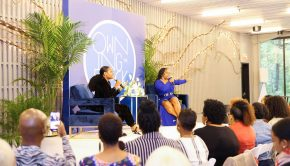 Celebrity event producer, Karleen Roy and Entrepreneur, Myleik Teele address the Owning the Block crowd